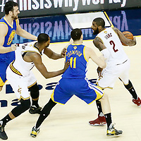 10 June 2016: Golden State Warriors guard Klay Thompson (11) and Golden State Warriors center Andrew Bogut (12) defend on Cleveland Cavaliers guard Kyrie Irving (2) and Cleveland Cavaliers center Tristan Thompson (13) during the Golden State Warriors 108-97 victory over the Cleveland Cavaliers, during Game Four of the 2016 NBA Finals at the Quicken Loans Arena, Cleveland, Ohio, USA.