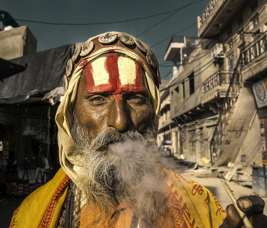 One of the many men that dress like Sadhus or holy man in Pushkar India. Many of them like the one in the picture are living from the money being given by pilgrims and tourists that visit this little city. This place is one of the five sacred pilgrimage site for any Hindu. It is also considered one of the oldest cities in India.Pushkar Lake is surrounded by 52 bathing ghats where pilgrims take a sacred bath. Over 500 Hindu temples are build around the lake.
