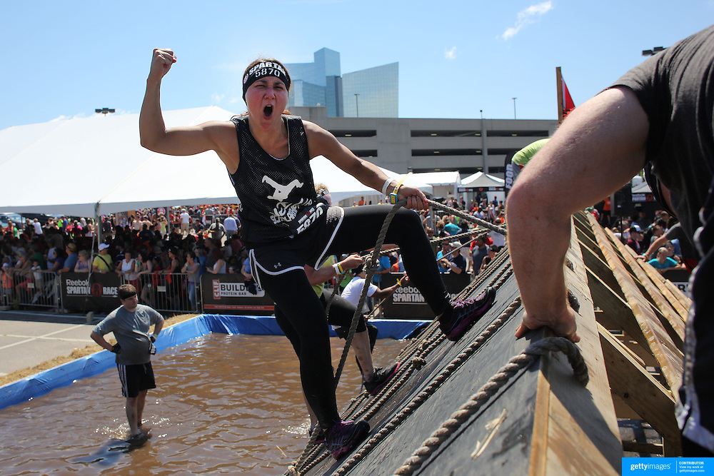 Anitra Bail in action at the slippery Wall obstacle during the Reebok Spartan Race. Mohegan Sun, Uncasville, Connecticut, USA. 28th June 2014. Photo Tim Clayton