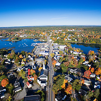 Early morning aerial view west over main street in Damariscotta, Maine. On the far side of the river is Newcastle, Maine.