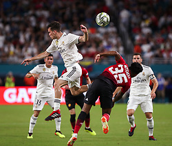 July 31, 2018 - Miami Gardens, Florida, USA - Real Madrid C.F. defender Luis Miguel Quezada (31) (left) disputes the ball with Manchester United F.C. midfielder Demetri Mitchell (35) (right) during an International Champions Cup match between Real Madrid C.F. and Manchester United F.C. at the Hard Rock Stadium in Miami Gardens, Florida. Manchester United F.C. won the game 2-1. (Credit Image: © Mario Houben via ZUMA Wire)