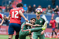 Emmanuel Riviere of Club Atletico Osasuna competes for the ball with Raul Garcia of Athletic Club during the match of  La Liga between Club Atletico Osasuna and Athletic Club Bilbao at El Sadar Stadium  in Pamplona, Spain. April 01, 2017. (ALTERPHOTOS / Rodrigo Jimenez)