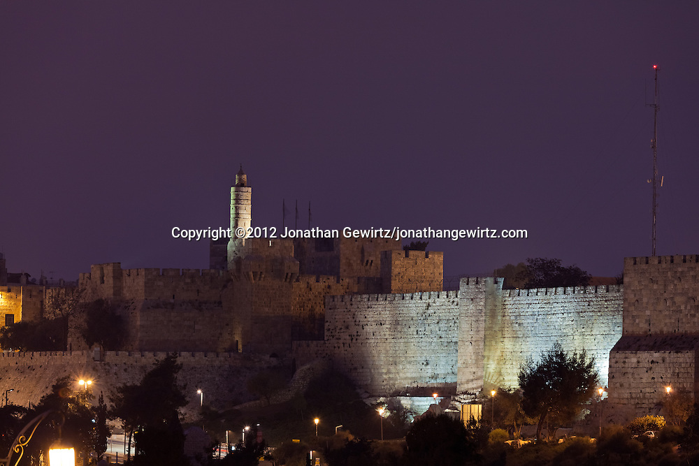 Night view of the Citadel or Tower of David and walls of Jerusalem's Old City. WATERMARKS WILL NOT APPEAR ON PRINTS OR LICENSED IMAGES.