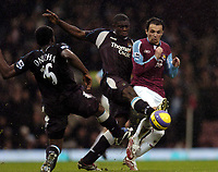 Photo: Olly Greenwood.<br />West Ham United v Manchester City. The Barclays Premiership. 30/12/2006. Manchester City's Micah Richards tackles West Ham's Matthew Etherington