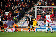Doncaster Rovers defender Andrew Butler heads the ball wide of the goal during the EFL Sky Bet League 1 match between Doncaster Rovers and Bradford City at the Keepmoat Stadium, Doncaster, England on 22 September 2018.