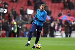 Tottenham Hotspur's Harry Kane warms up before the Premier League match at the Emirates Stadium, London.