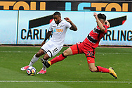 Luciano Narsingh of Swansea city (l) is tackled by Christopher Schindler of Huddersfield Town (r). Premier league match, Swansea city v Huddersfield Town at the Liberty Stadium in Swansea, South Wales on Saturday 14th October 2017.<br /> pic by  Andrew Orchard, Andrew Orchard sports photography.