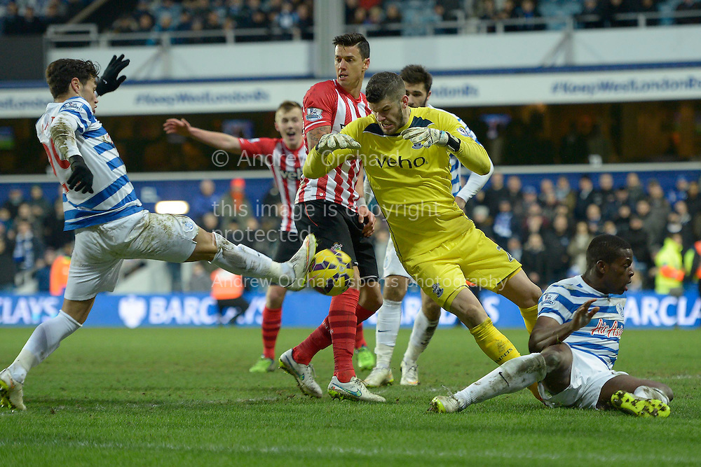 Mauro Zarate of QPR puts  the ball past  Goalkeeper Fraser Forster of Southampton but the 'goal' is disallowed. . Barclays Premier league match, Queens Park Rangers v Southampton at Loftus Road in London on Saturday 7th Feb 2015. pic by John Patrick Fletcher, Andrew Orchard sports photography.
