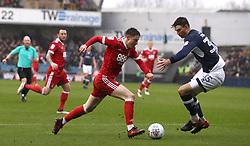 Nottingham Forest's Joe Lolley (left) runs at Millwall's Jake Cooper