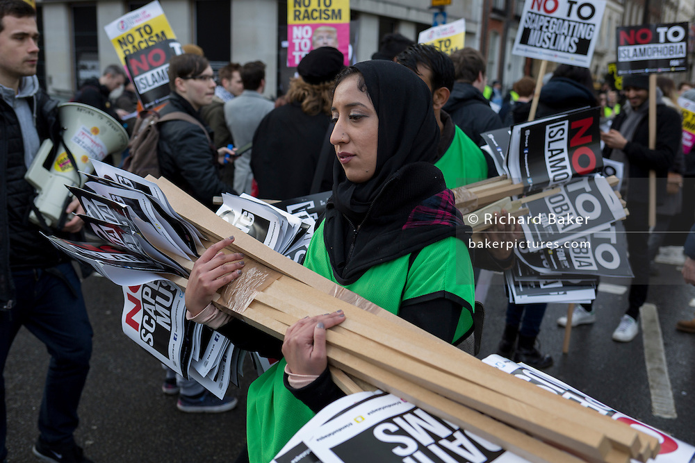A young Muslim woman activist at the Stop Trump's Muslim ban demonstration on 4th February 2017 in London, United Kingdom. The protest was called on by Stop the War Coalition, Stand Up to Racism, Muslim Association of Britain, Muslim Engagement and Development, the Muslim Council of Britain, CND and Friends of Al-Aqsa. Thousands of demonstrators gathered to demonstrate against Trump's ban on Muslims, saying it must be opposed by all who are against racism and support basic human rights, and for Theresa May not to collude with him.