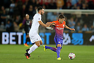 John Stones of Manchester city breaks away from Borja of Swansea city.   EFL Cup. 3rd round match, Swansea city v Manchester city at the Liberty Stadium in Swansea, South Wales on Wednesday 21st September 2016.<br /> pic by  Andrew Orchard, Andrew Orchard sports photography.
