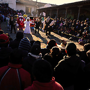 A crowd watches a dancing procession of people dressed in costumes of cartoon and historical figures in the mail square as part of Convite de 12 Dicembre in Chichicastengo. Chichicastenango is an indigenous Maya town in the Guatemalan highlands about 90 miles northwest of Guatemala City and at an elevation of nearly 6,500 feet. It is most famous for its markets on Sundays and Thursdays.