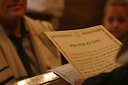Jewish wedding with an Italian style ketubah (prenuptial agreement) in the foreground