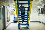 A prisoner walking up stairs onto his wing. HMP/YOI Portland, Dorset. A resettlement prison with a capacity for 530 prisoners. <br /> Portland, Dorset, United Kingdom.