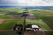 Nederland, Noordoostpolder, 30-06-2011; Lindenweg (tussen Emmeloord en Luttelgeest). De Noordoostpolder (NOP), is een voorbeeld van moderne grootschalige polder met rationele verkaveling. De aanleg van de polder maakte  deel uit van de Zuiderzeewerken (plan Lely) en viel in 1942 droog. De meeste boerderijen (en dorpen) zijn van na de tweede wereldoorlog..The northeast polder (NOP), is an example of modern large-scale polder with rational allotment. The construction of the polder was part of the Zuiderzee Works (Lely plan), in 1942 the polder was dry. Most of the building, farmhouses and villages, is post-war..luchtfoto (toeslag), aerial photo (additional fee required).copyright foto/photo Siebe Swart