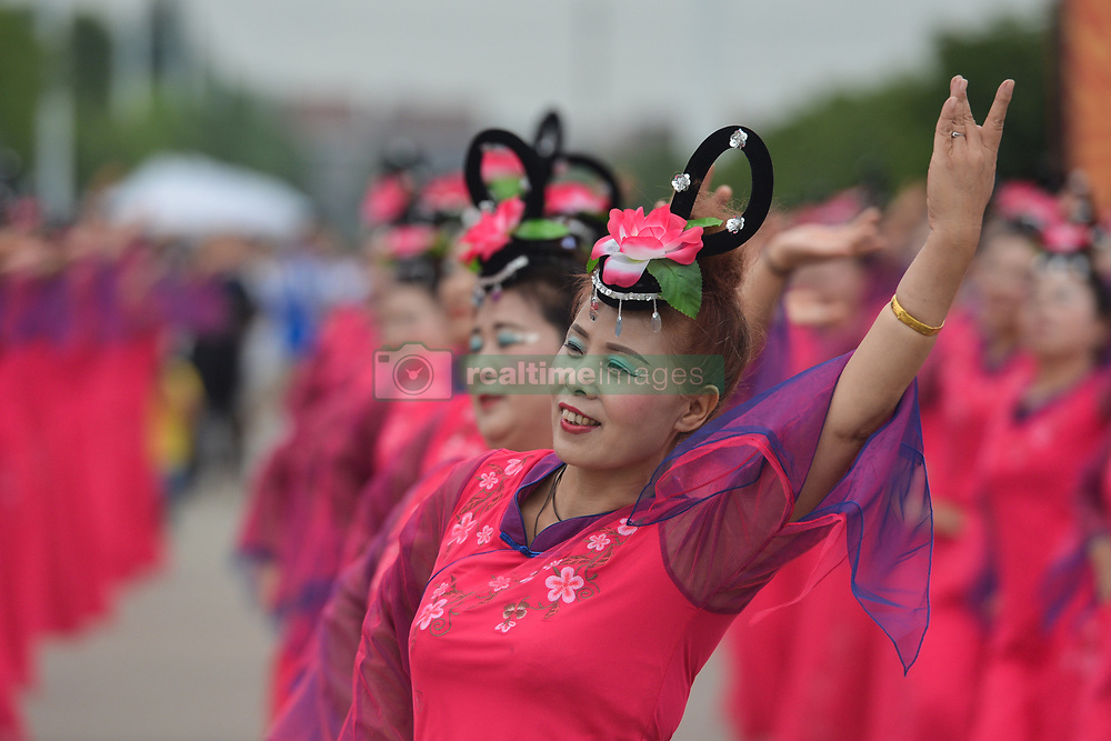 September 20, 2017 - Changde, China - Demonstration of a local folk dances ahead of the start to the second stage of the 2017 Tour of China 2, the 97.6km Changde Lixiang Circuit Race. .On Wednesday, 20 September 2017, in Lixian County, Changde City, Hunan Province, China. (Credit Image: © Artur Widak/NurPhoto via ZUMA Press)