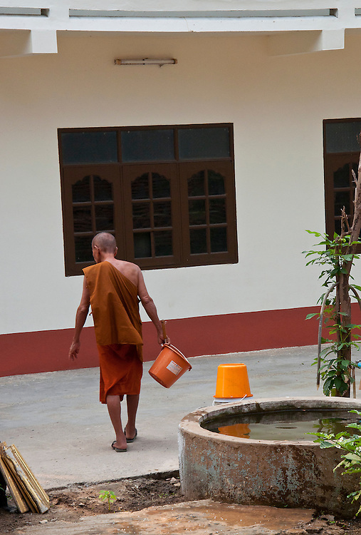 Monk going about his daily business, Ayutthaya city, Thailand.