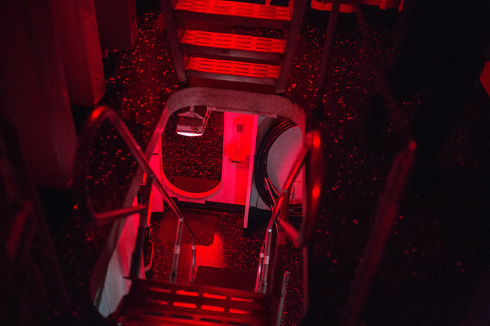 During nighttime hours most of the ship is bathed in red light, preserving night vision for crew members<br /> <br /> Aboard the USS Harry S. Truman operating in the Persian Gulf. February 25, 2016.<br /> <br /> Matt Lutton / Boreal Collective for Mashable