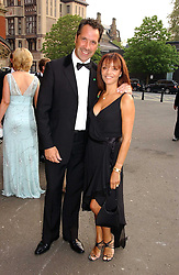 Footballer DAVID SEAMAN and his wife DEBBIE at the NSPCC's Dream Auction held at The Royal Albert Hall, London on 9th May 2006.<br /><br />NON EXCLUSIVE - WORLD RIGHTS