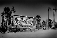 A ghost town of sorts: Entrance to a failed, closed down water park in the middle of the Mojave Desert, east of Baker, California on the highway to Las Vegas, USA.  The desert is a graveyard of unfulfilled dreams.