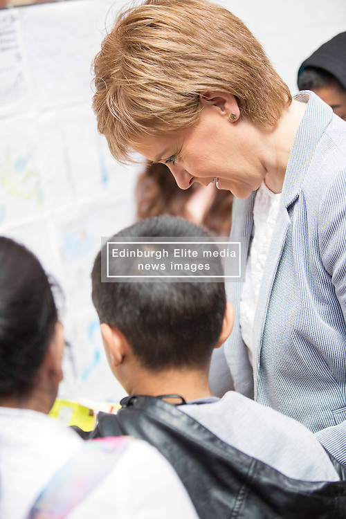 Pictured:  First Minister Nicola Sturgeon<br /> <br /> Scotland's First Minister, Nicola Sturgeon, MSP, carry on with her pubklic duties today without any visible sign of additional security. Ms Sturgeon attended as part of the judging panel as the pupils of Annette Street and St Bride's Primary schools had been involved in a competition to design how the Govanhill baths might look when they re open the pool. thje First Minister was relaxed and chatted to all the children and helped hand out medals and prizes<br /> Karen Gordon  <br /> 18 June 2016<br /> <br /> <br /> (c) Karen Gordon   Edinburgh Elite media