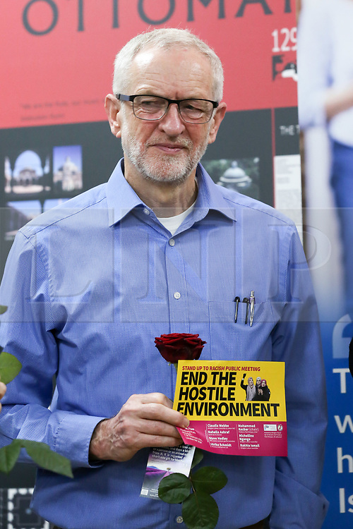 © Licensed to London News Pictures. 03/03/2019. London, UK. bour leader Jeremy Corbyn holds a leaflet during the fourth Visit My Mosque Day at Finsbury Park Mosque in North London. Over 250 mosques open their doors to non-Muslim guests and visitors on the fourth Visit My Mosque Day. This year the national event also encourages mosques to support Keep Britain Tidy's Great British Spring Clean campaign with many already taking part in cleaning their communities. Photo credit: Dinendra Haria/LNP