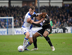 Ollie Clarke of Bristol Rovers tussles with Neil Danns of Bury - Mandatory by-line: Neil Brookman/JMP - 30/03/2018 - FOOTBALL - Memorial Stadium - Bristol, England - Bristol Rovers v Bury - Sky Bet League One