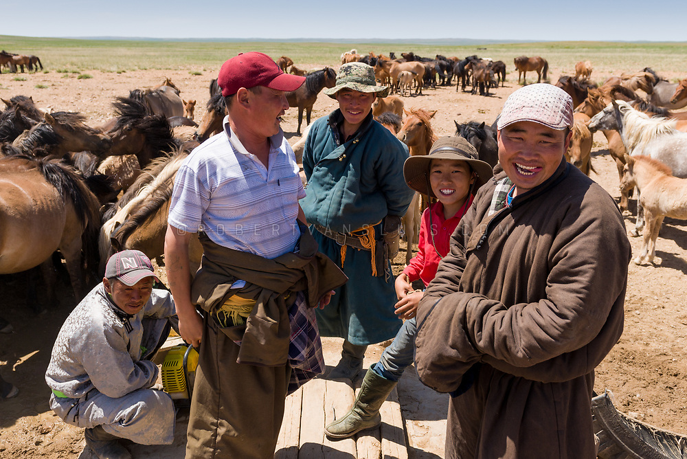 A group of horse wranglers take a break from watering their horses in Dundgov Province, Mongolia. Photo ©robertvansluis.com