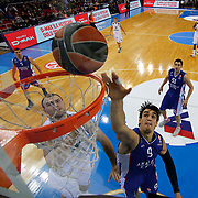 Anadolu Efes's Dario Saric (R) during their Turkish Airlines Euroleague Basketball Group A Round 9 match Anadolu Efes between Nizhny Novgorod at Abdi ipekci arena in Istanbul, Turkey, Friday December 12, 2014. Photo by Aykut AKICI/TURKPIX
