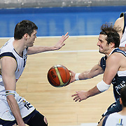 Fenerbahce's Darjus LAVRINOVIC (L) and Efes Pilsen's Kerem TUNCERI (2ndR) during their Turkish Basketball Legague Play-Off semi final first match Fenerbahce between Efes Pilsen at the Sinan Erdem Arena in Istanbul Turkey on Tuesday 24 May 2011. Photo by TURKPIX