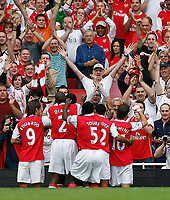 Photo: Steve Bond.<br />Arsenal v Derby County. The FA Barclays Premiership. 22/09/2007. Emmanual Adebayor celebrates scoring from the penalty spot in front of the home fans