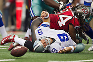 DALLAS, TX - SEPTEMBER 23:  Tony Romo #9 of the Dallas Cowboys fumbles the ball after being hit by Michael Bennett #71 of the Tampa Bay Buccaneers at Cowboys Stadium on September 23, 2012 in Dallas, Texas.  The Cowboys defeated the Buccaneers 16-10.  (Photo by Wesley Hitt/Getty Images) *** Local Caption *** Tony Romo; Michael Bennett Sports photography by Wesley Hitt photography with images from the NFL, NCAA and Arkansas Razorbacks.  Hitt photography in based in Fayetteville, Arkansas where he shoots Commercial Photography, Editorial Photography, Advertising Photography, Stock Photography and People Photography