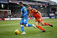 Peterborough Utd midfielder Siriki Dembélé (10) on the ball watched by Luton Town defender Matty Pearson (6) during the EFL Sky Bet League 1 match between Luton Town and Peterborough United at Kenilworth Road, Luton, England on 19 January 2019.