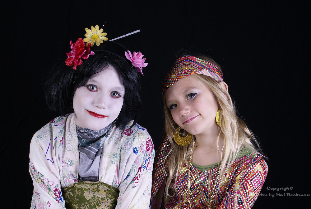 A portrait of two sisters dressed up for Halloween.