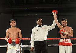 Referee raises Lee Haskins arm to pronounce him the winner. - Photo mandatory by-line: Alex James/JMP - Mobile: 07966 386802 - 02/12/2014 - SPORT - Boxing - Bristol - Bristol City academy - Lee Haskins v Willy Velazquez - Boxing