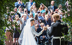 Prince Harry and Meghan Markle on the steps of St George's Chapel in Windsor Castle after their wedding.