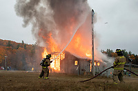 Gilford Fire Department working a controlled burn at Gunstock's Phelps Barn on Saturday afternoon.  (Karen Bobotas Photo/for The Laconia Daily Sun)
