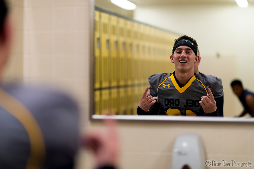Del Oro Golden Eagle's Matthew Kruger (18), gets ready inside the locker room before the game as the Del Oro Golden Eagles varsity football team host the Oak Ridge Trojans, Friday Oct 21, 2016.<br /> photo by Brian Baer