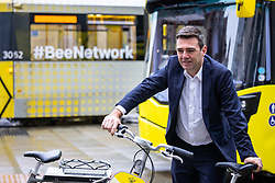 """© Licensed to London News Pictures . 02/10/2021. Manchester, UK. On the eve of the Conservative Party Conference, Greater Manchester Metro Mayor ANDY BURNHAM , Bolton Council Leader Martyn Cox and Local Enterprise Partnership Chair Lou Cordwell launch a campaign for an integrated public transport service for Manchester , along the lines of that available in London. The """" Destination: Bee Network """" would integrate bus, tram and bicycle networks and reduce the cost of fares as part of what is described as a Levelling Up Deal . The Conservative Party Conference takes place at the Manchester Central Exhibition Centre from tomorrow (3rd October 2021). Photo credit: Joel Goodman/LNP"""