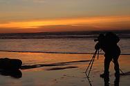 Photographer, sunset, beach, silhouette, Morro Bay, California