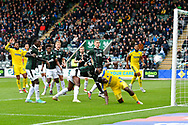The ball goes wide after Deji Oshilaja (4) of AFC Wimbledon heads wide under pressure from Yann Songo'o (4) of Plymouth Argyle during the EFL Sky Bet League 1 match between Plymouth Argyle and AFC Wimbledon at Home Park, Plymouth, England on 6 October 2018.