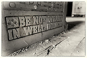 Inspirational words carved onto a stone block in abandoned Lillesden Girl's School