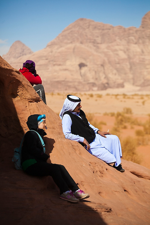 Zedane al-Zalabieh, owner and manager of the Bedouin Meditation Camp, relaxes with clients in the desert of Wadi Rum, Jordan.