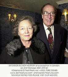 SIR SIMON & LADY HORNBY at a reception in London on 31st October 2001.OTR 81