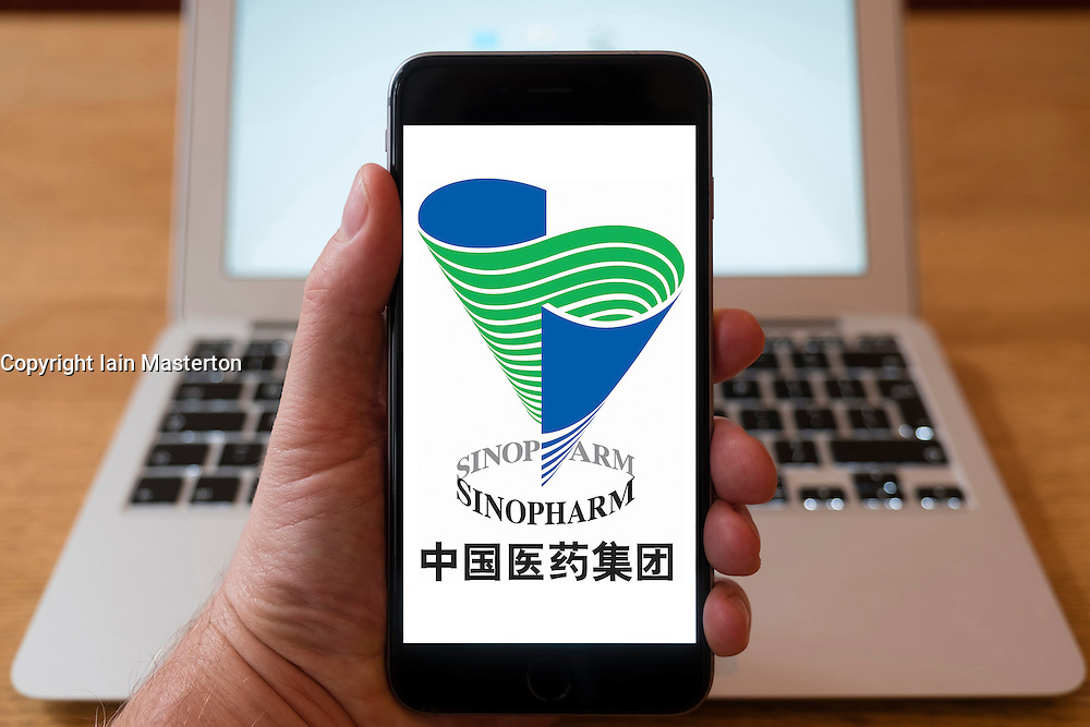 Using iPhone smartphone to display logo of Sinopharm, Chinese pharmaceutical company