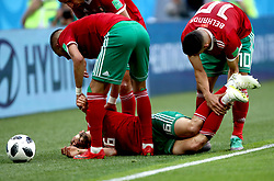 Morocco's Nordin Amrabat appears unconscious on the pitch after suffering a collision