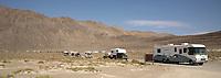 Vehicles make their way onto the playa.