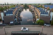 Nederland, Amersfoort,   20180530<br /> Wijk Nieuwland. In Nieuwland werd rond 1999 een van de eerste milieuwijken gebouwd met grootschalige toepassing van zonne-energie. In een paar straten werd het hele dak volgelegd met pv-panelen. <br />  <br /> Foto: (c)Michiel Wijnbergh