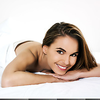 beautiful  woman lying on a white bed
