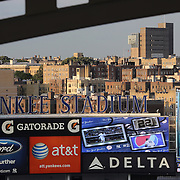 The Yankee Stadium sign with the early evening light catching the buildings outside the stadium during the New York Yankees V New York Mets Subway Series Baseball game at Yankee Stadium, The Bronx, New York. 8th June 2012. Photo Tim Clayton